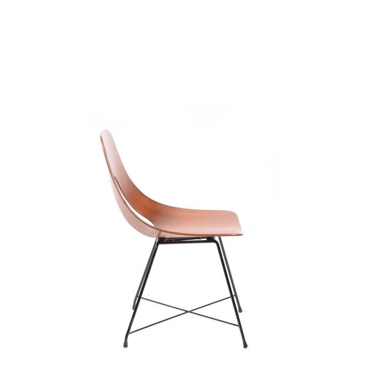 Molded teak plywood side chair on black painted steel base.