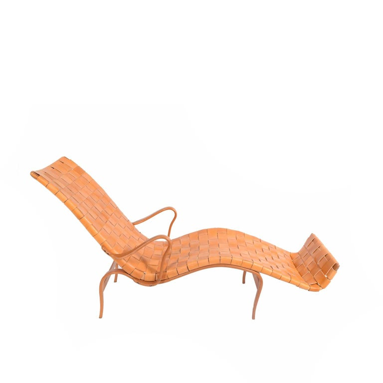 Signed, early Bruno Mathsson 'Pernila Three' chaise longue with frame of laminated beechwood and leather straps made by Karl Mathsson. Newer straps.