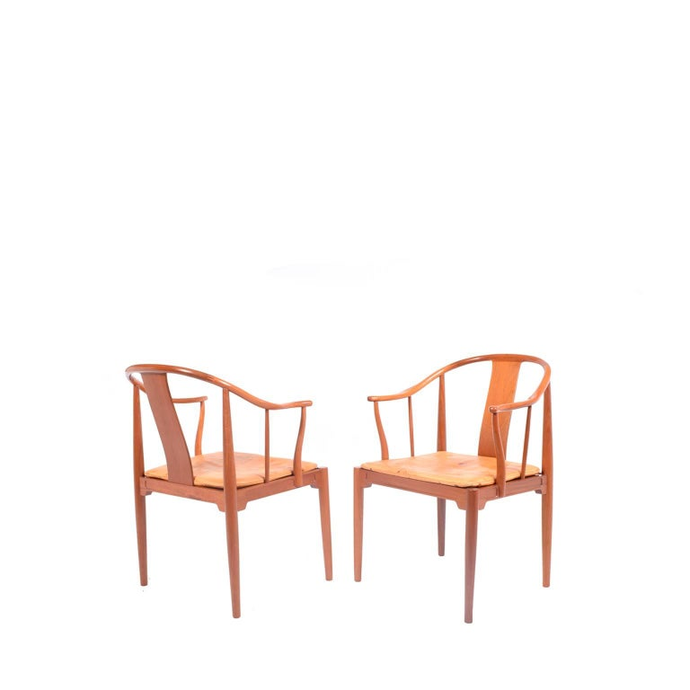 Solid mahogany armchairs with natural leather cushions designed by Hans Wegner for Fritz Hansen in 1944. Inspiration came from a 1400 Chinese chair he saw in a museum.