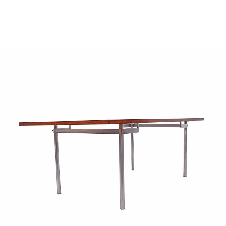 Brazilian rosewood table desk design by Hans Wegner for Andreas Tuck chrome legs sign on the bottom.