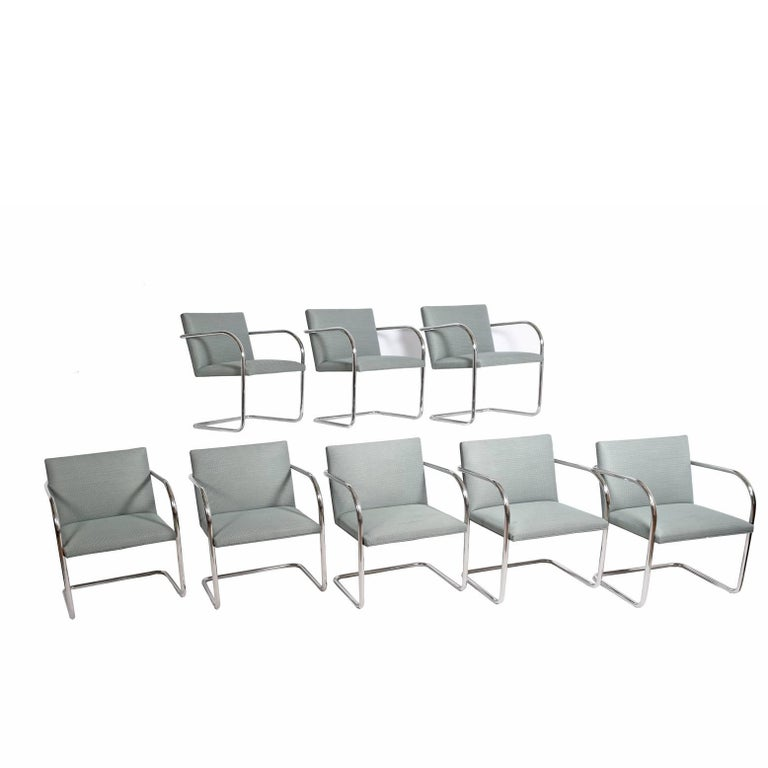 Eight stainless steel Classic tubular Brno chairs, original contract Knoll fabric Made by Knoll Inc. Measure: Arm height 25.75
