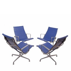 Four Aluminium Group Chairs by Charles Eames for Herman Miller