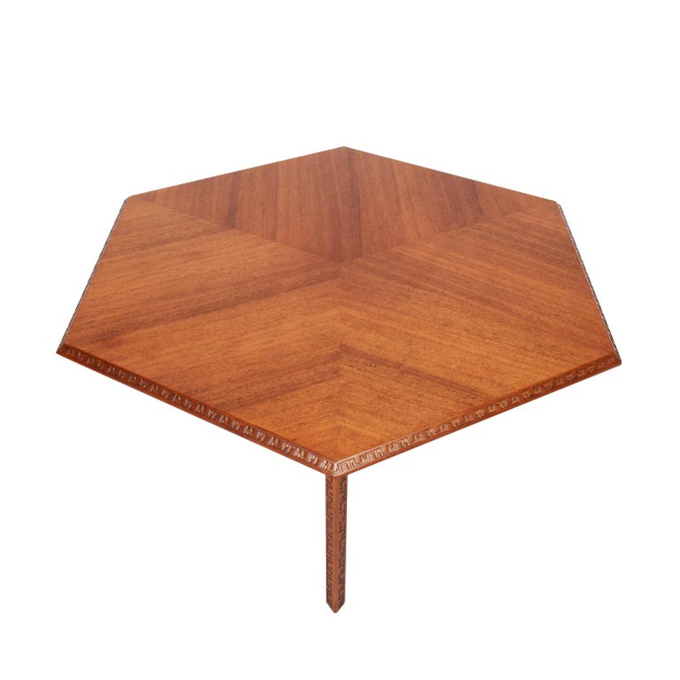 Mahogany six-sided coffee table with Taliesen designed hand-curved edge. Signed with manufacturer's mark. Made by Heritage Henredon.