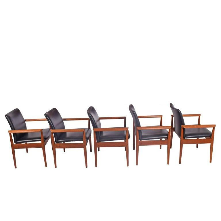 Solid teak frame with Naugahyde upholstery designed by Finn Juhl in 1961. Manufactured by France & Son. Label on each chair.