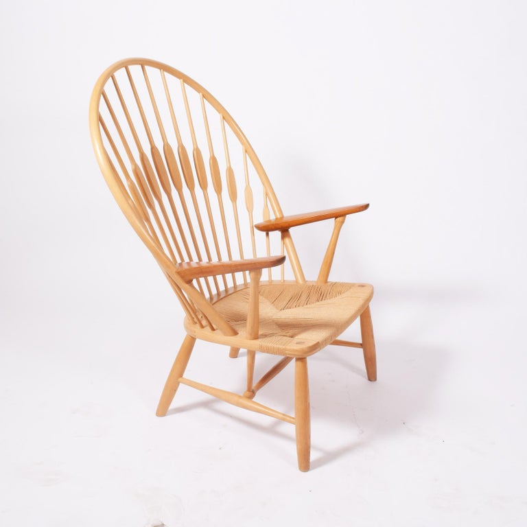 Solid ash back frame and spindles, solid teak arms on Danish woven papercord seat. Solid tapering legs. Marked on frame with manufacturer's mark. Made by Johannes Hansen. Designed 1947, this example, circa 1970s.
