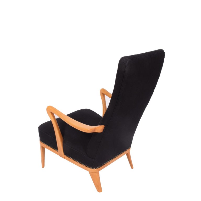Birch sculptural arms and legs with exposed edge upholstered in black linen fabric.