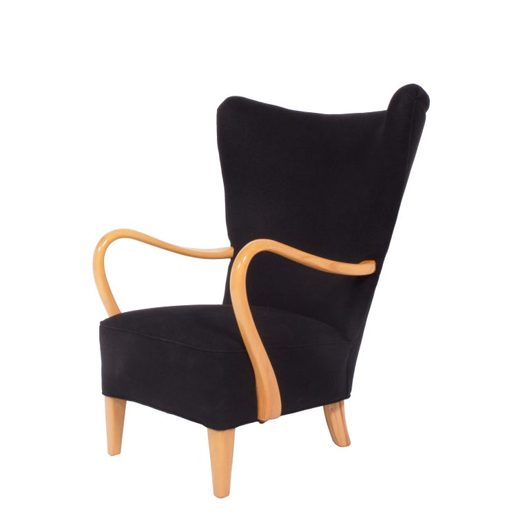 Solid birch sculptural arms and legs, free-form easy chair spring system seat new black linen upholstery. Drawing of similar example Svenska Möbler 1890-1990 page 229.