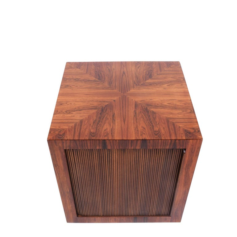 Brazilian rosewood bar cube on wheels with tambour door. Design number stamped on the bottom.