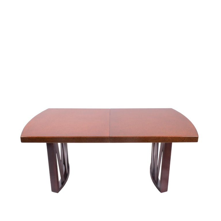 Beautifully designed dining table with cork top and cross-slatted mahogany base. Two 11.25
