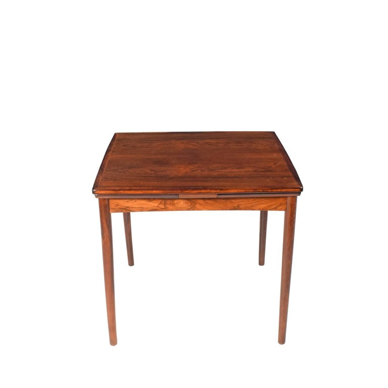 Danish reversible top game table, bottom part with leather inlay, with two extensions for a small dining table sign in ink Danish furniture control, plus manufacture initials, each leave 12.5.