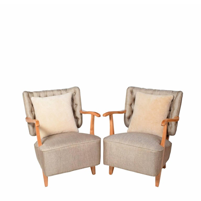 Solid ashwood, open arms and legs with spring system seat and tufted back. Two sheep skin back cushions for comfort included.