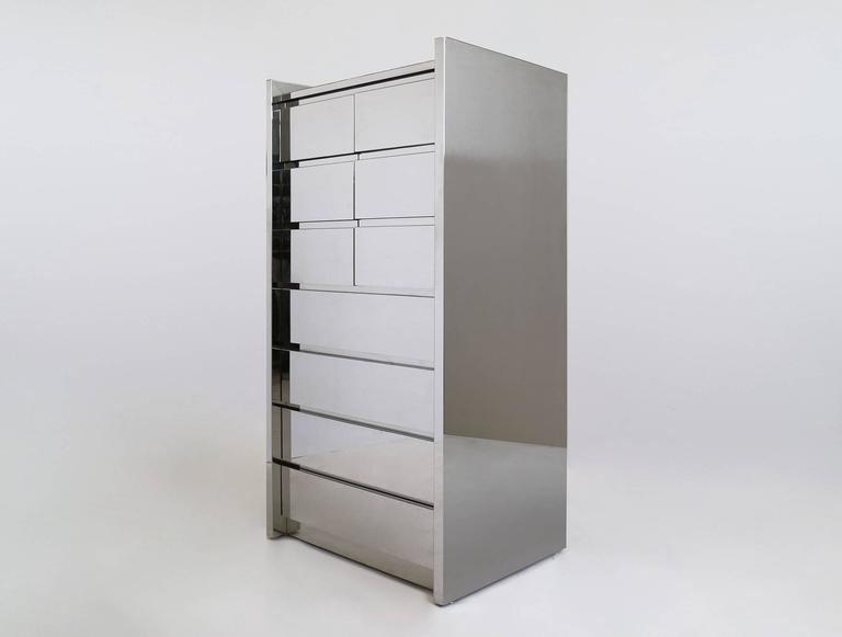 Karl Springer LTD., four drawer case with upper storage compartment, hinged doors, adjustable shelf. High polished stainless steel with mirror glass surface top.