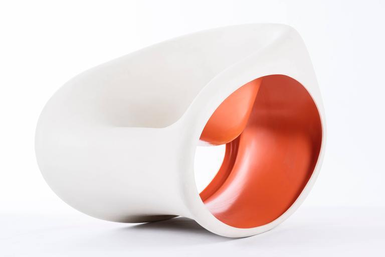 Designed by Ron Arad for Driade. Molded polyethylene. Ivory white exterior and orange interior.