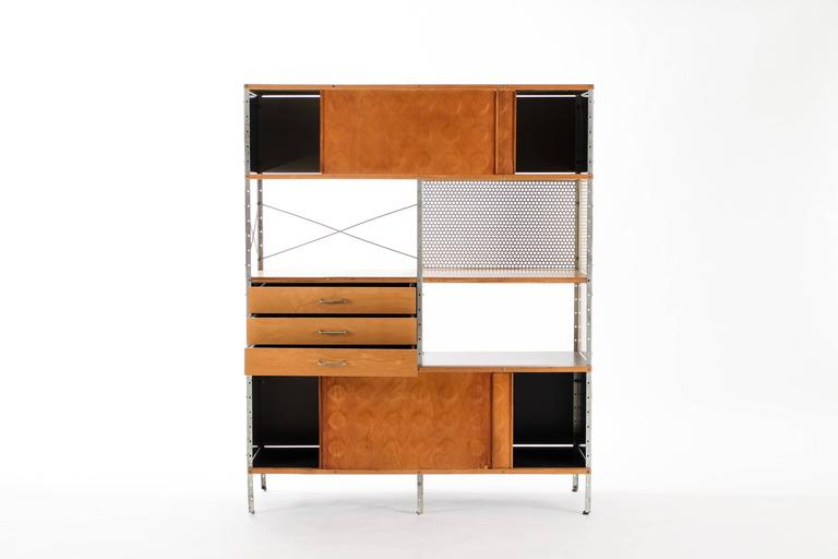 This Eames storage unit features three drawers and four sliding doors concealing storage. Signed with applied manufacturer's label to drawer: [Herman Miller Furniture Company Designed by Charles Eames].