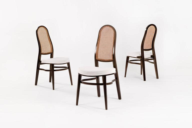 Wormley for Dunbar dining chairs, canned backs with newly upholstered cotton velvet seats, mahogany frames crafted highly skilled bent multiple layers of veneer, front legs crafted with twisted design detail. Showing image 9.