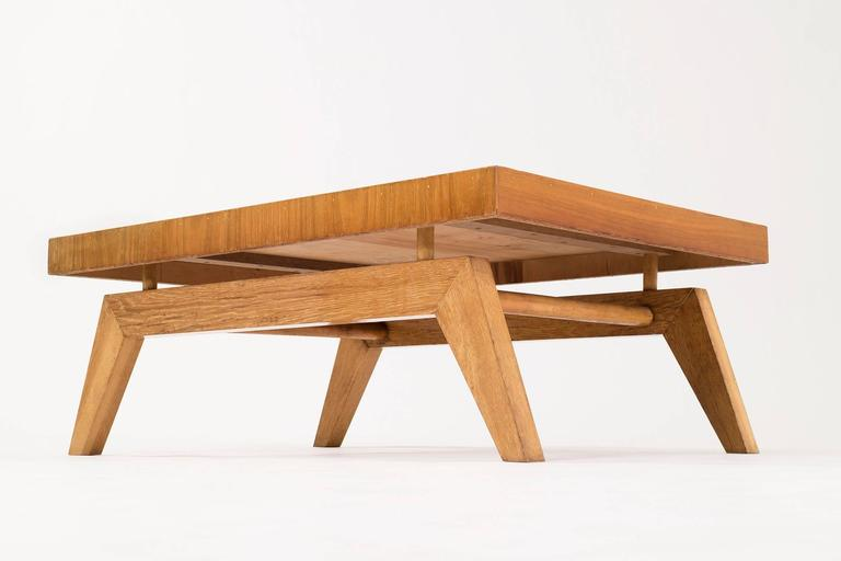 Rare Maloof cocktail table, features floating top with splayed legs.
