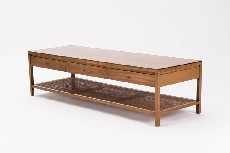 Paul McCobb for Calvin. Model 8739 from the Irwin collection. Table features three drawers with brass pulls and solid aluminium edge on top perimeter.