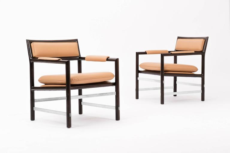 Edward Wormley Janus Collection for Dunbar. Solid oak frames with stainless steel stretchers that connect the legs. The chair have their original finish and have been reupholstered in Spinneybeck leather.