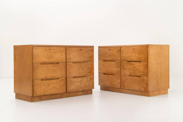 Early pair of Aalto cabinets for Finsven. This set of cabinets features six drawers and is constructed from birth plywood.