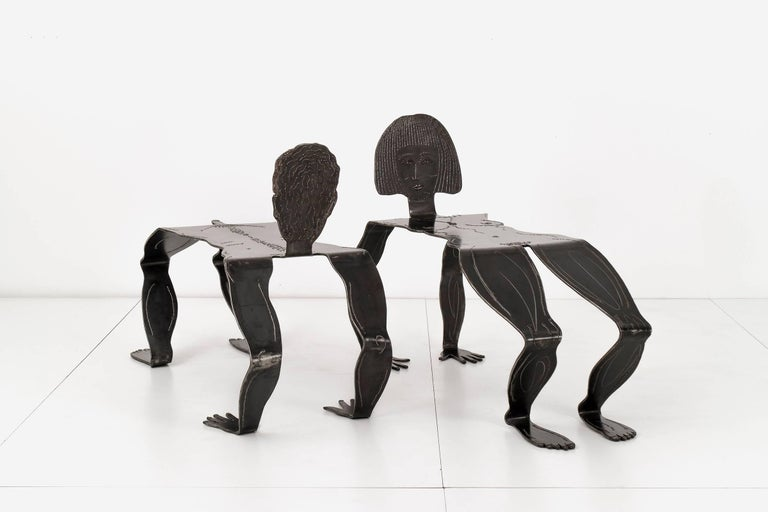 Two metal figures as benches designed by RLM. Signed & RLM '95 Ralph P-727; on the underside of the male and & RLM '95 P-707t; on the female. Sturdy and heavy. They are lacquer-coated for outdoor use. Both sculptures showing no weathering or