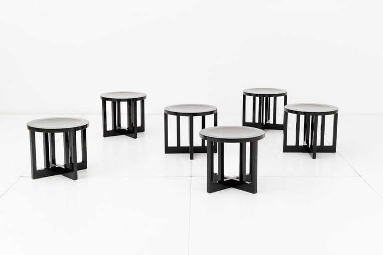 Set of six Richard Meier Model 820 low stools for Knoll. Laminated hard maple veneers and solid hard maple. Mortise and tenon construction. Hand-rubbed black lacquer-urethane finish. Richard Meier's personal mark is inscribed on the underside of