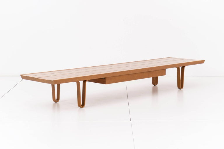 Long John bench or coffee table designed by Edward Wormley for Dunbar. Tongue and groove walnut top with drawer, supported by bentwood hairpin legs.