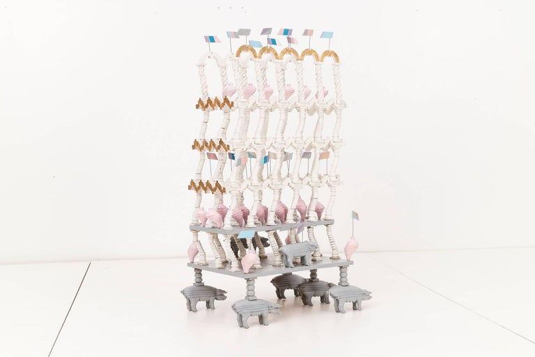 Monumental Pedro Friedeberg surrealist sculpture; Friedeberg's playful and flamboyant inspired mind, showing a display of geometrically sliced pigs, columns and flags, stacked totemic wedding cake like sculpture.  Friedeberg Museum show at Museo