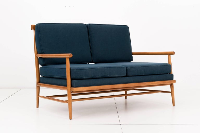 McCobb Windsor back settee Birchwood with spindle back, turned wood arms and legs.