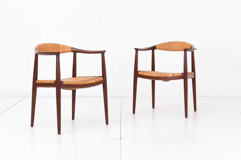 Wegner for Johannes Hansen, Eight teak and cane armchairs. Signed with branded manufacturer's mark to underside of all examples: [Johannes Hansen Copenhagen, Denmark].
