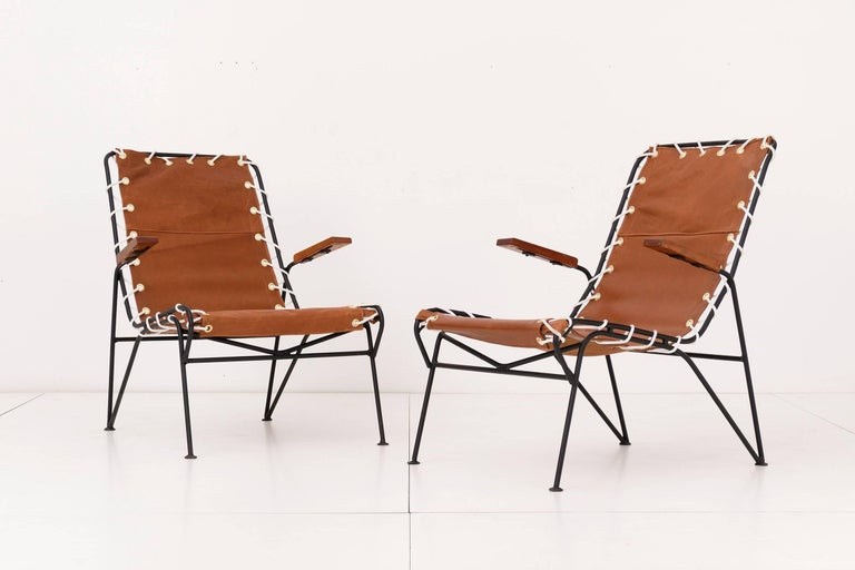 Saarinen Swanson for Ficks Reed the sol-air pair of lounge chairs with Edelman leather slings.
