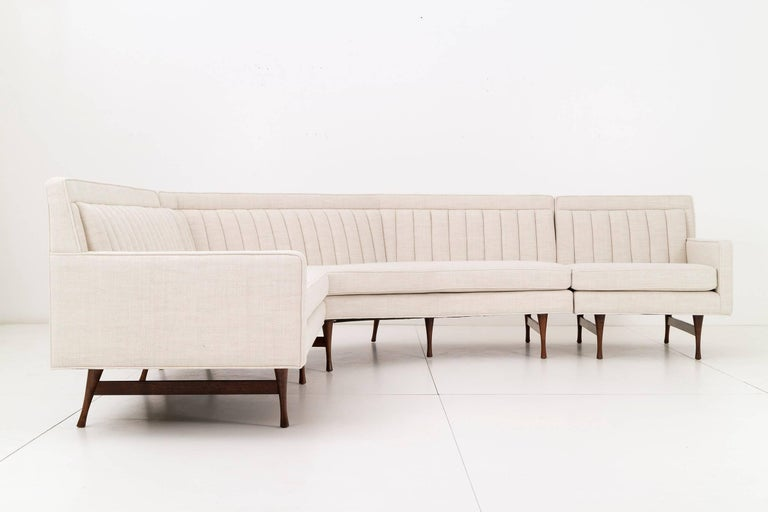 Three piece sectional sofa designed by Paul McCobb for Widdicomb. Rebuilt and restored to exact specifications, including quilted pattern under seat cushion.