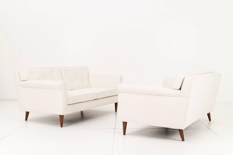 Wormley Settees for Dunbar. Features button-tufted back cushions, reupholstered with Great Plains cotton-poly.