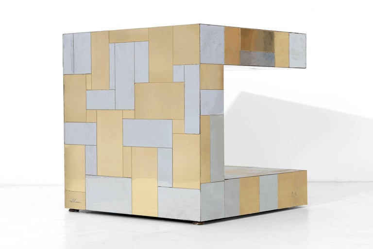 'C' shaped Paul Evans Cityscape side table, covered in polished steel and brass tiles.