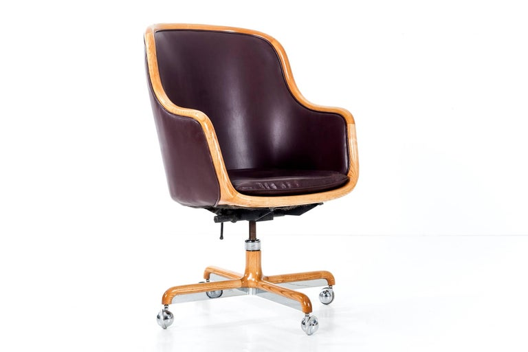 Mahogany dyed original leather with white oak trim accents, oak chrome base. Chair tilts and swivels with adjustable height. Dimensions of the heights are as pictured and can be adjusted. Measure: Arm heights is also currently at 28