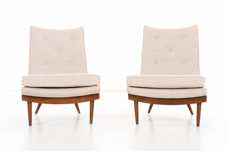 Nakashima for Widdicomb origins, lounge chairs solid walnut turned legs, upholstered with great plains bouclé, tufted button backs. Measures: seat height 15.