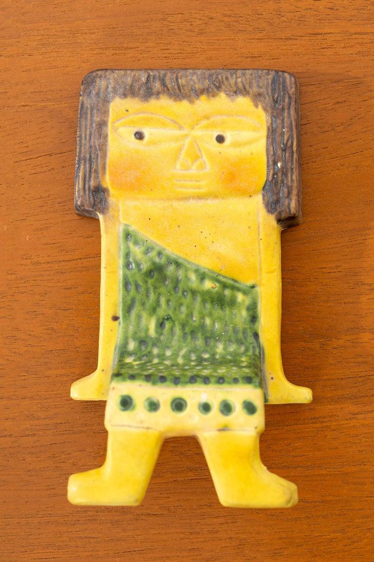 Marcello Fantoni for Raymor ceramic shelf hanging person. Glazed Ceramic. Cat pictured sold separately.