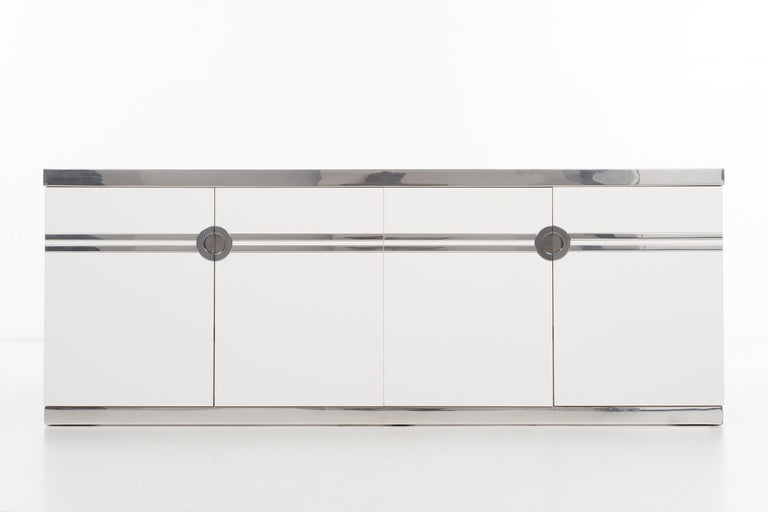 Pierre Cardin for Dillingham cabinet, wood, chrome and laminate 4-door case concealing 6 drawers. Full circle decorative pulls, with multiple chrome accents. [signed].