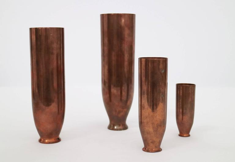 """Four copper vases that nest in a matryoshka doll fashion.  Stamped and singed on underside, made in Italy, Faenza.  Dimensions are as follows for the 3 smaller vases. H: 7.25"""" D: 2""""  H: 5.5"""" D: 1.5""""  H: 3.5"""" D:"""