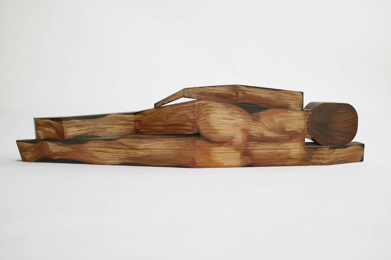 Carved and painted wood sculpture by Carol Quinn.  This item is currently on view in our NYC Greenwich Street Location.