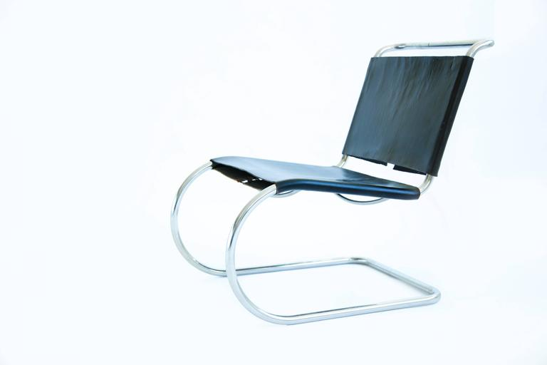 Mies cantilever lounges, model MR 30/5. Black belting leather used as slings, tubular chrome-plated steel.  Earl Knoll, no longer in production.