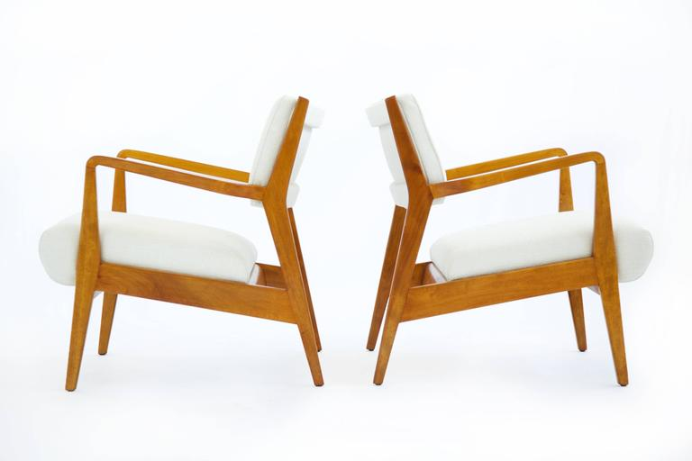 Pair of Early Jens Risom Lounge Chairs, solid cherry-wood articulated arms and frame, reupholstered with Great Plains woven fabric.