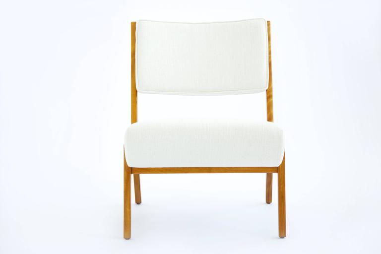 Risom lounge chair, solid cherry-wood reupholstered with Great Plains woven fabric.