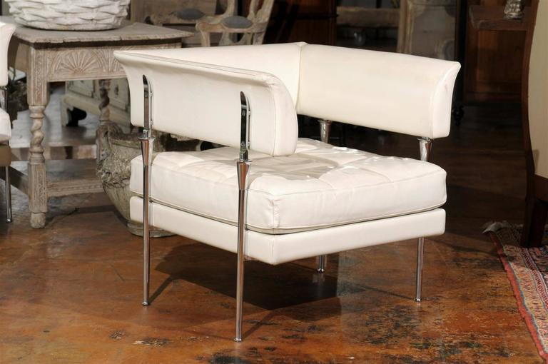 This pair of Italian Hydra Castor armchairs were designed by renowned artist Luca Scacchetti in 1992 for Poltrona Frau, the famed Italian furniture firm. The chairs are upholstered in a high quality white Pelle leather. The wrap-around backs and