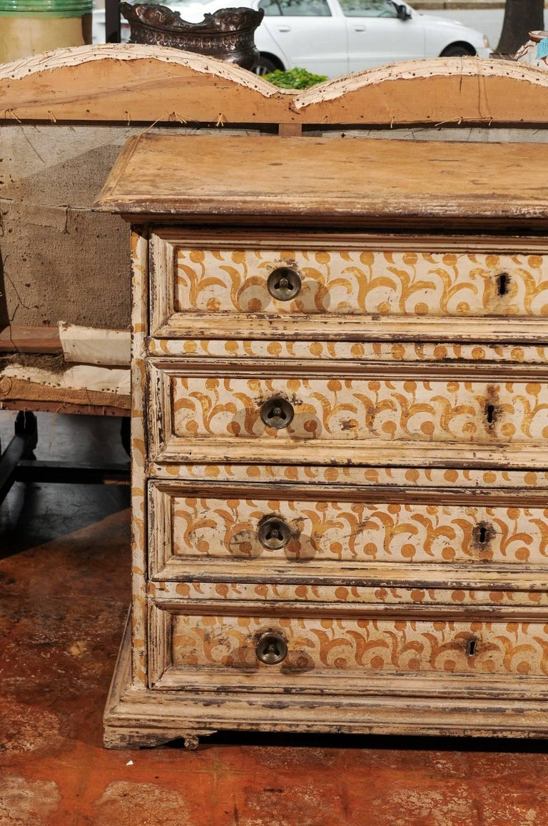 Italian 17th Century Florentine Tall Four-Drawer Commode with Painted Floral Motifs For Sale