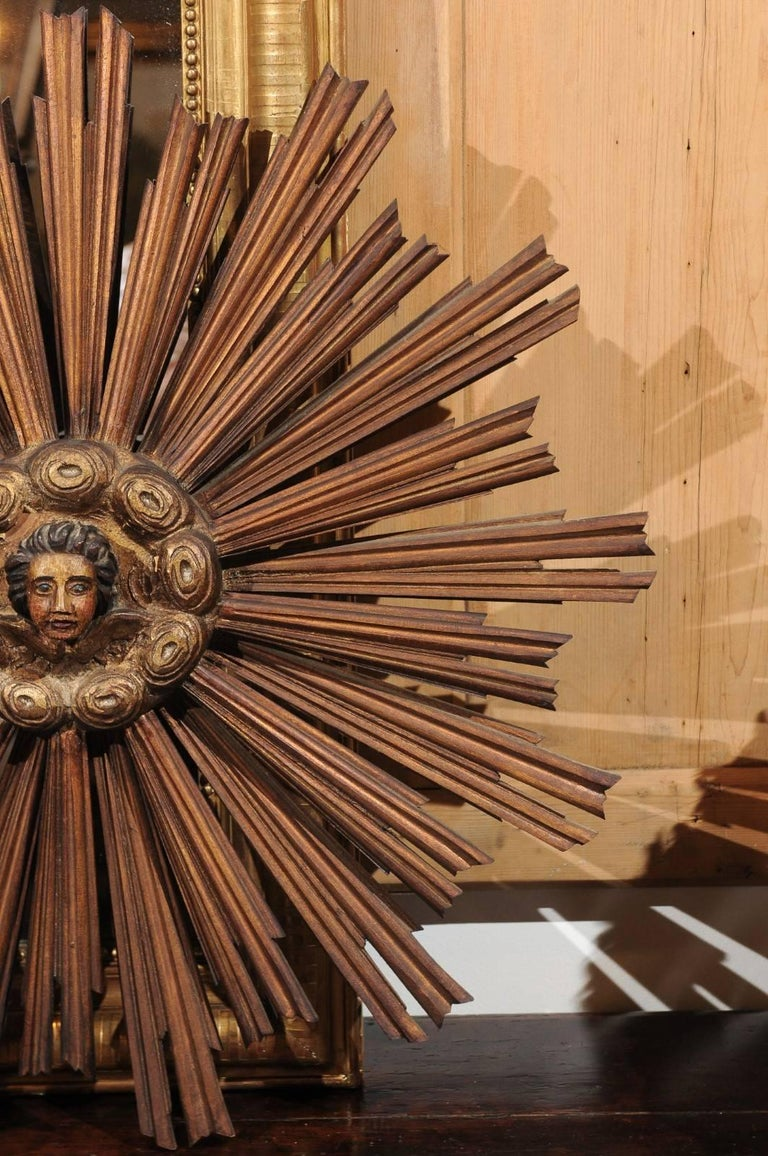 Wood French 19th Century Gilt and Painted Starburst with Carved Angel Face and Clouds For Sale