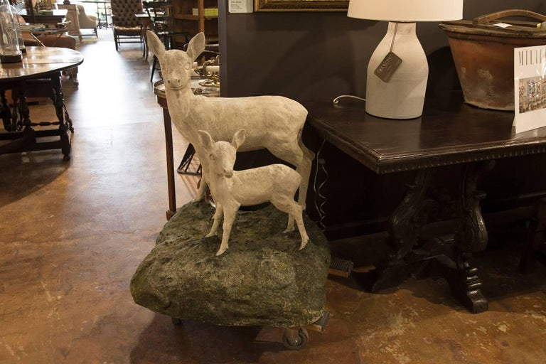 Mid-Century Modern Pair of English Mid-Century Cast Stone Sculptures of a Doe and Her Fawn on Base For Sale