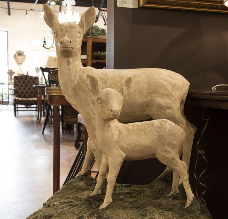 Pair of English Mid-Century Cast Stone Sculptures of a Doe and Her Fawn on Base In Good Condition For Sale In Atlanta, GA
