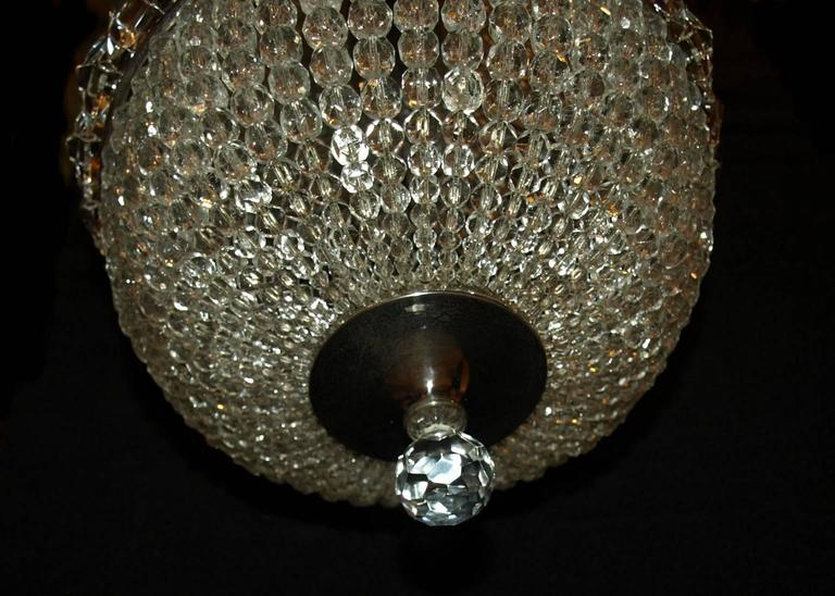 Petite basket style chandelier with one inside light.