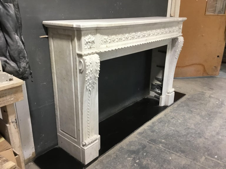 An antique Louis XVI style chimneypiece  In Fair Condition For Sale In London, GB