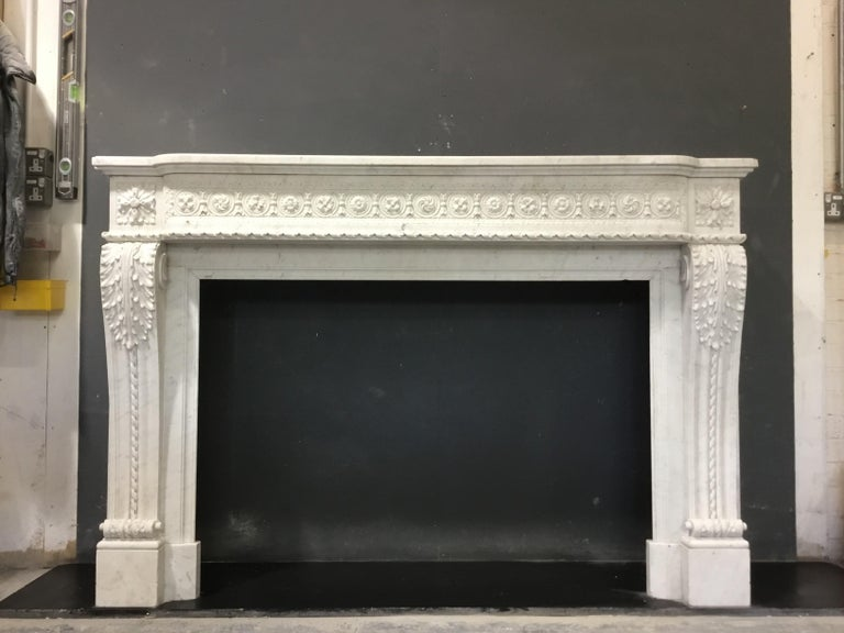 An antique Louis XVI style chimneypiece  For Sale